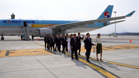 It touched down at Incheon International Airport, west of Seoul, in the safe hands of former figure skating champion Yuna Kim (R) and South Korea's Culture, Sports and Tourism Minister, Do Jong-Hwan.