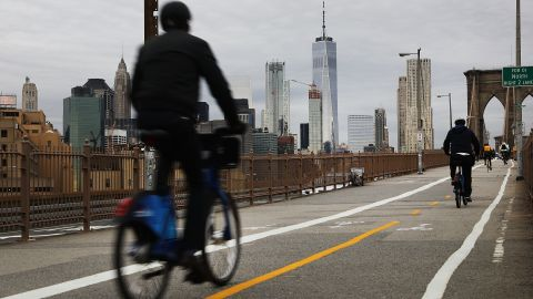 NEW YORK, NY - NOVEMBER 01:  People ride bikes across an unusally quiet Brooklyn Bridge the morning after what is being described as a terrorist attack in lower Manhattan on November 1, 2017 in New York City.  Eight people were killed and 12 were injured on Tuesday afternoon when suspect 29-year-old Sayfullo Saipov, a legal resident from Uzbekistan, intentionally drove a truck onto a bike path in lower Manhattan.  (Photo by Spencer Platt/Getty Images)