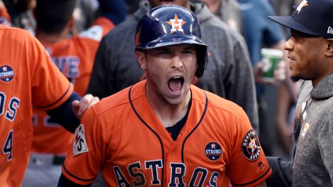 Bregman reacts after scoring the opening run of the game.