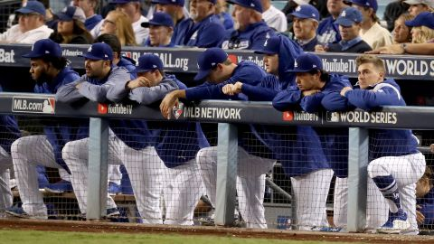 The Dodgers watch from the top step of the dugout during the eighth inning. They fell behind 5-0 after two innings and never got much momentum going.