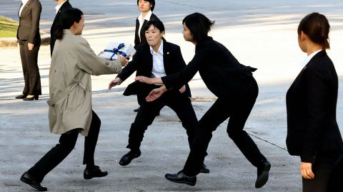 Female police officers wearing suits take part in a training on November 1 in Tokyo.