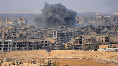 Smoke billows from Deir Ezzor during an operation against ISIS fighters on Thursday.