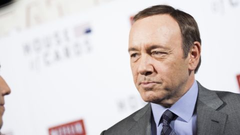 """Kevin Spacey speaks with members of the press on the red carpet during Netflix's """"House Of Cards"""" screening in Washington, DC on January 29, 2013."""