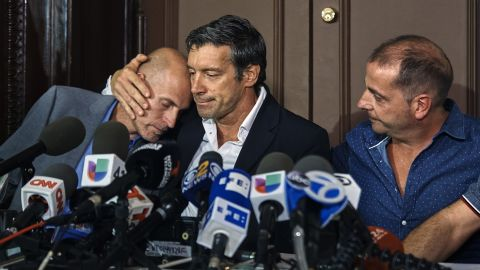 Argentine friends Ivan Brajkovic, from left, Guillermo Banchini and Ariel Benvenuto say they are in pain.