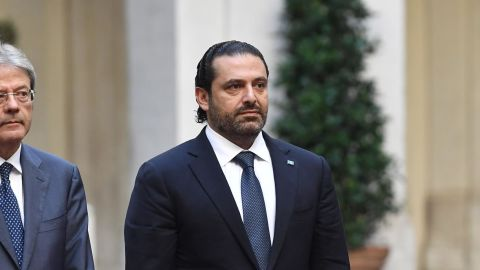 Italian Prime Minister Paolo Gentiloni (L) welcomes his Lebanese counterpart Saad Hariri before their meeting on October 16, 2017 at the Palazzo Chigi in Rome. / AFP PHOTO / Tiziana FABI        (Photo credit should read TIZIANA FABI/AFP/Getty Images)