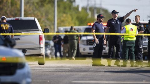 Law enforcement officials work the shooting scene.