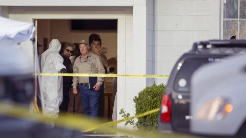 Investigators work at the scene. Victims range in age from 17 months to 77 years old.<br />