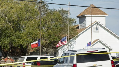 Flags are lowered to half staff at First Baptist Church following the shooting.