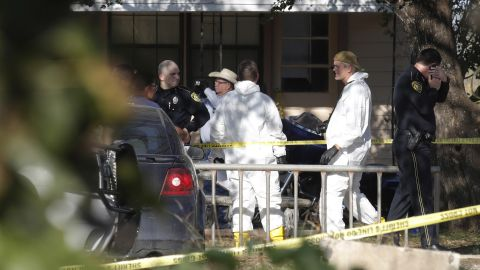 Law enforcement officials and forensic experts gather at the scene.