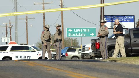 Law enforcement officials gather near the First Baptist Church. The shooter was killed after a brief chase north into neighboring Guadalupe County, according Guadalupe County Sheriff's Office spokesman Robert Murphy.