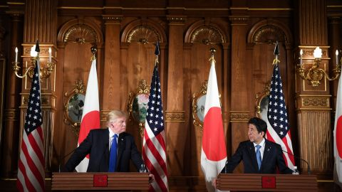 """US President Donald Trump and Japanese Prime Minister Shinzo Abe (R) attend a joint press conference at Akasaka Palace in Tokyo on November 6, 2017. Donald Trump described North Korea's nuclear missile programme as a """"threat"""" to the world on a trip to Asia dominated by the crisis. / AFP PHOTO / JIM WATSON        (Photo credit should read JIM WATSON/AFP/Getty Images)"""