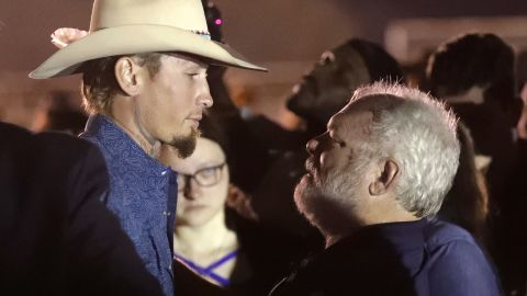 Stephen Willeford, right, hugs Johnnie Langendorff during a vigil for the victims of the First Baptist Church shooting Monday, Nov. 6, 2017, in Sutherland Springs, Texas. Willeford shot suspect Devin Patrick Kelley and Langendorff drove the truck while they chased Kelley. Kelley opened fire inside the church in the small South Texas community on Sunday, killing more than two dozen and injuring others. (AP Photo/David J. Phillip