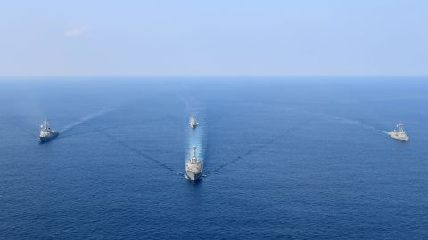 A photo released by the South Korean Navy shows the US, South Korea and Australia participating in joint naval drills.