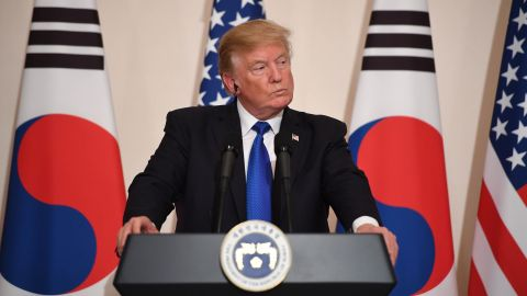 """US President Donald Trump attends a joint press conference with South Korea's President Moon Jae-In at the presidential Blue House in Seoul on November 7, 2017.US President Donald Trump arrived in Seoul on November 7 vowing to """"figure it all out"""" with his South Korean counterpart Moon Jae-In, despite the two allies' differences on how to deal with the nuclear-armed North. / AFP PHOTO / Jim WATSON        (Photo credit should read JIM WATSON/AFP/Getty Images)"""