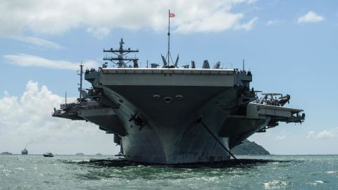 The USS Ronald Reagan (CVN-76) aircraft carrier is involved in search and rescue operations.