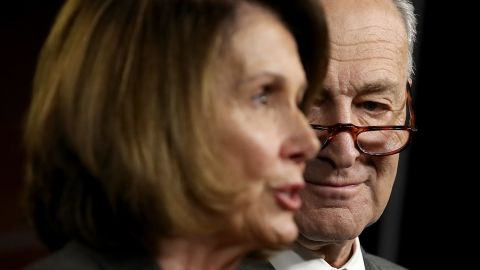 WASHINGTON, DC - NOVEMBER 02:  Sennate Minority Leader Chuck Schumer (R) (D-NY) listens as House Minority Leader Nancy Pelosi (D-CA) speaks during a press conference where congressional Democrats reacted to the newly introduced Republican tax reform proposal November 1, 2017 in Washington, DC. Tax reform legislation is a centerpiece of U.S. President Donald Trump's legislative agenda.  (Photo by Win McNamee/Getty Images)