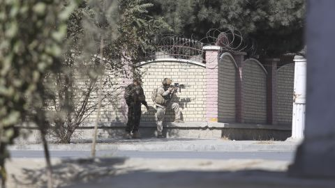 Afghan security personnel take a position near the Shamshad Television after an attack in Kabul, Afghanistan, Tuesday, Nov. 7, 2017. Jan Agha, a police officer, says a gun man attacked on the local TV. (AP Photo/Rahmat Gul)
