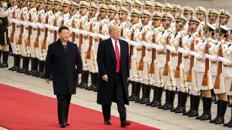 """US President Donald Trump and XI take part in a welcome ceremony at the Great Hall of the People on Thursday, November 9, 2017, in Beijing during <a href=""""http://www.cnn.com/interactive/2017/11/politics/trump-asia-tour-cnnphotos/index.html"""" target=""""_blank"""">Trump's visit to Asia. </a>"""