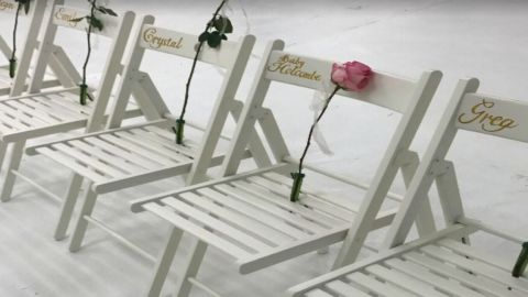 A single pink rose was placed on a chair in honor of the unborn child.