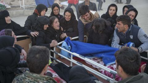 Iranians mourn over the body of a victim following a 7.3-magnitude earthquake in Sarpol-e Zahab in Iran's western province of Kermanshah.