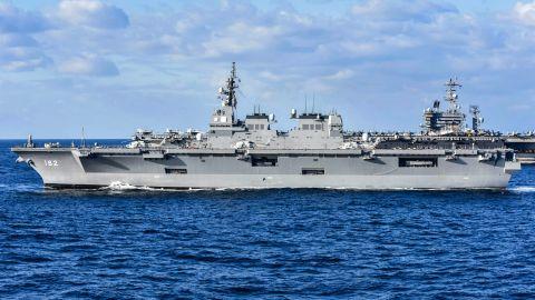 Japan's Maritime Self-Defense Force helicopter destroyer JS Ise sails alongside the USS Nimitz.