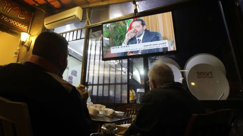 Lebanese watch an interview with Lebanon's resigned prime minister Saad Hariri at a coffee shop in Beirut on November 12, 2017.