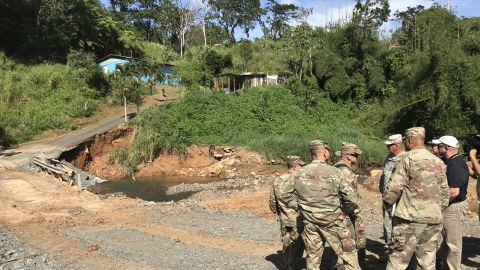 Buchanan and colleagues survey a damaged road in Maricao.