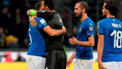 Italians Andrea Barzagli, Gianluigi Buffon, Giorgio Chiellini and Marco Parolo console each other after defeat by Sweden