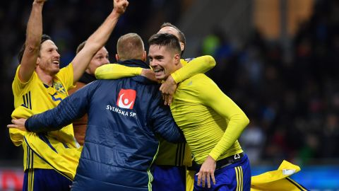 Sweden's players celebrate after qualifying for the World Cup for the first time since 2006