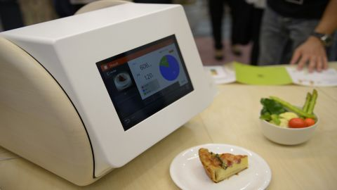 """<a href=""""http://gccatapult.panasonic.com/en/calorieco/"""" target=""""_blank"""" target=""""_blank"""">CaloRieco</a> uses infrared signals to measure the nutrients of a meal, within an accuracy range of 20%, according to manufacturer Panasonic."""