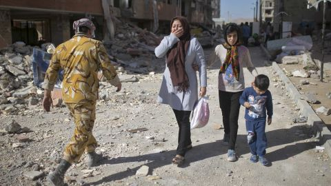 """People react as they make their way through Sarpol-e Zahab, Iran, on Tuesday, November 14, two days after a magnitude 7.3 earthquake <a href=""""http://www.cnn.com/2017/11/14/asia/iran-iraq-earthquake/index.html"""" target=""""_blank"""">devastated the region</a> along the Iran-Iraq border area. Hundreds were killed and thousands were hurt, officials said."""