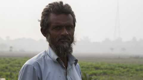 """""""Where can we go? It's people like us that suffer,"""" says Mohammed Najeeb, a small scale farmer who lives in a slum along the banks of the Yamuna River."""