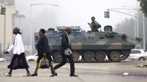 """An armored vehicle patrols a street in Harare on Wednesday, November 15. In a dramatic televised statement, an <a href=""""http://www.cnn.com/2017/11/14/africa/zimbabwe-military-chief-treasonable-conduct/index.html"""">army spokesman denied that a military takeover was underway,</a> but the situation bore all the hallmarks of one. The military said Mugabe and his family were """"safe."""""""