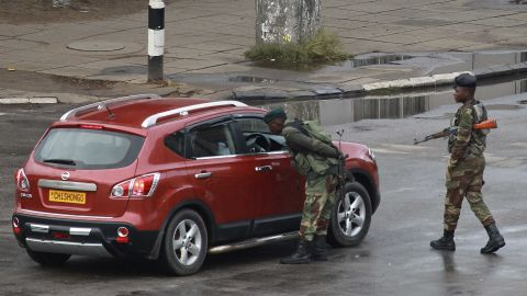 Soldiers inspect a vehicle on a road leading to Mugabe's office in Harare on November 15.