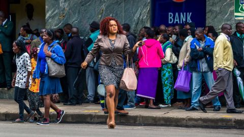 Residents in Zimbabwe's capital line up to withdraw money from a bank on November 15.