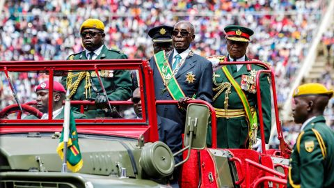 Mugabe reviews the guard of honor during Zimbabwe's 37th Independence Day celebrations in April 2017.