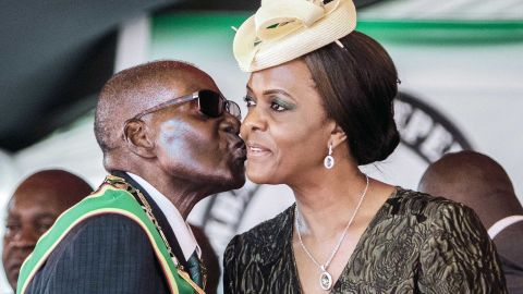 """Mugabe kisses his wife during Independence Day celebrations in April 2017. In early November, the<a href=""""http://edition.cnn.com/2017/11/07/africa/zimbabwe-mugabe-vice-president-mnangagwa/index.html"""" target=""""_blank""""> sacking of Mugabe's longtime ally and vice president, Emmerson Mnangagwa,</a> was seen as a move to potentially clear the way for Grace Mugabe to succeed her 93-year-old husband."""