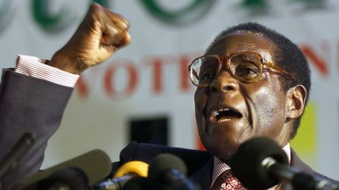 HARARE, ZIMBABWE:  Zimbabwean President Robert Mugabe clenches his fist to salute Zanu PF comrades in Harare, 03 May 2000. Mugabe launched his ruling party election manifesto today ahead the upcoming elections. (ELECTRONIC IMAGE) AFP PHOTO  ODD ANDERSEN. (Photo credit should read ODD ANDERSEN/AFP/Getty Images)