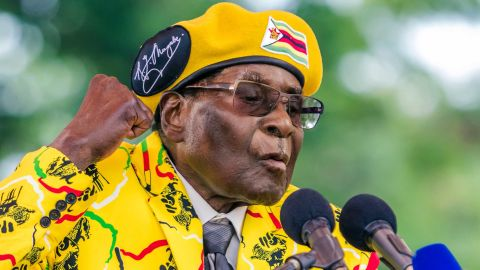 Zimbabwe's President Robert Mugabe addresses party members and supporters gathered at his party headquarters to show support to Grace Mugabe becoming the party's next Vice President after the dismissal of Emerson Mnangagwa November 8 2017.Zimbabwe's sacked vice president, Emmerson Mnangagwa, said on November 8, 2017, he had fled the country, as he issued a direct challenge to long-ruling President Robert Mugabe and his wife Grace. / AFP PHOTO / Jekesai NJIKIZANA        (Photo credit should read JEKESAI NJIKIZANA/AFP/Getty Images)