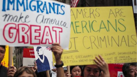 Protesters hold up signs during a demonstration against US President Donald Trump during a rally in support of the Deferred Action for Childhood Arrivals (DACA), also known as Dream Act, near the Trump Tower in New York on October 5, 2017.  / AFP PHOTO / Jewel SAMAD        (Photo credit should read JEWEL SAMAD/AFP/Getty Images)
