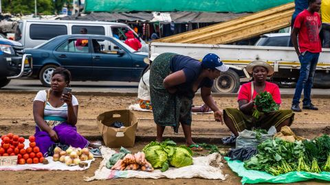 Business continues as usual in Harare as roadside vendors sell vegetables on November 16.