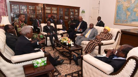 """Mugabe, right, is seen in talks about his future in this image <a href=""""https://twitter.com/caesarzvayi/status/931198110575054848"""" target=""""_blank"""" target=""""_blank"""">tweeted by Caesar Zvayi,</a> the editor of The Herald newspaper, on Thursday, November 16."""