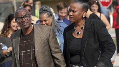 Wilbert Jones holds hands with his niece Wajeedah Jones as he leaves East Baton Rouge Parish Prison on Wednesday.