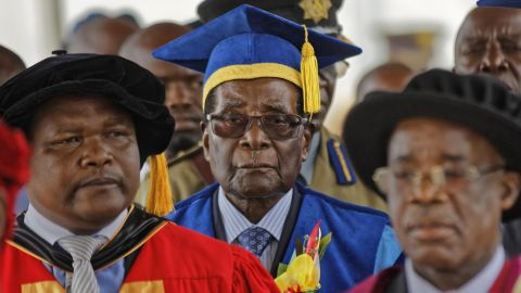 Mugabe, center, arrives to preside over a student graduation ceremony at Zimbabwe Open University on Friday, November 17. It was his first public appearance since the military takeover.