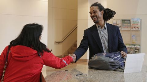 Braxton Winston, right, greets a supporter as he arrives for an orientation meeting at the government center in Charlotte, N.C., Thursday, Nov. 9, 2017.