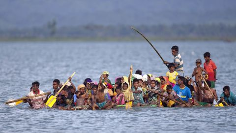 Rohingya Muslims cross the Naf River on a makeshift raft from Myanmar to Bangladesh.
