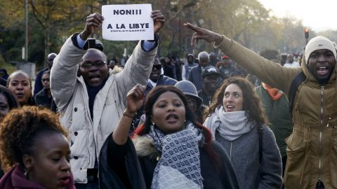 """A man holds a placard reading """"No to slavery in Libya"""" during a march against """"slavery in Libya"""" on November 18 in Paris."""