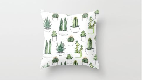 """<strong>V: Vicky Webb Throw Pillow ($22.49; </strong><a href=""""http://www.anrdoezrs.net/links/8314883/type/dlg/sid/1217azgiftguide/https://society6.com/product/watercolour-cacti-and-succulent_pillow?sku=s6-2410254p26a18v129a25v193"""" target=""""_blank"""" target=""""_blank""""><strong>society6.com</strong></a><strong>) </strong>"""