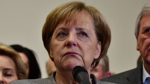 German Chancellor and leader of the Christian Democratic Union (CDU) party, Angela Merkel, looks on while speaking after exploratory talks on forming a new government broke down on November 19, 2017 in Berlin. Tough talks to form Germany's next government stretched into overtime, putting Chancellor Angela Merkel's political future in the balance since failure to produce a deal could force snap elections. / AFP PHOTO / Tobias SCHWARZ        (Photo credit should read TOBIAS SCHWARZ/AFP/Getty Images)