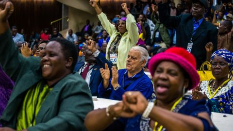 Members of the ruling party ZANU-PF react after the decision to oust Mugabe as party leader on November 19.